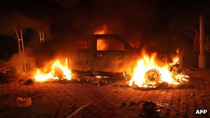 Car in flames inside the US consulate compound in Benghazi on 11/9/12