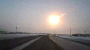 Meteor streaking across the sky