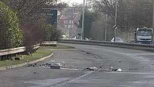 Debris on the road at the crash site