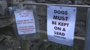Warning signs asking people to keep their dogs on leads