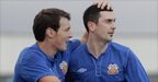 Kyle Neill congratulates Glenavon goalscorer Mark Farren at New Grosvenor