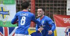 Philip Lowry is congratulated by Brian McCaul after putting Linfield in front against Glentoran