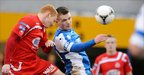 Joseph McNeill and Ryan Harpur in aerial action as Dungannon beat Portadown 2-0