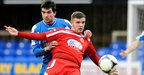 Dungannon defender Emmett Friars tries to halt the progress of Portadown forward Darren Murray