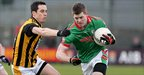Aaron Kernan challenges Darren Dolan for possession during the Club Football semi-final at Mullingar