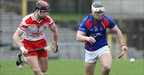 Neil McGarry and Bernard Burke vie for possession as Loughgiel surrender their All-Ireland crown