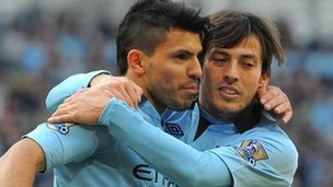 Manchester City striker Sergio Aguero (left) celebrates scoring with David Silva