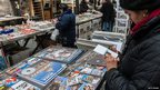 People buy souvenirs in St Peter's Square on 17/2/13