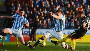 Callum McManaman (left) scores for Wigan