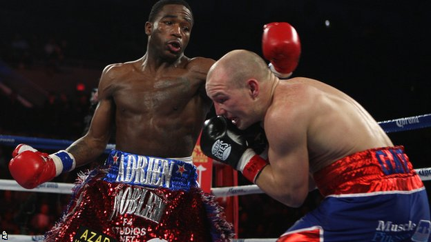 Adrien Broner lands a left on Gavin Rees