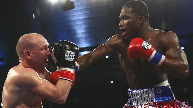 Gavin Rees takes a solid right from WBC lightweight champion Adrien Broner