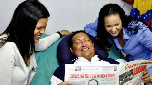 Hugo Chavez with his daughters in a Cuban hospital