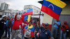 Supporters of President Hugo Chavez outside the military hospital in Caracas, 18 Feb 2013