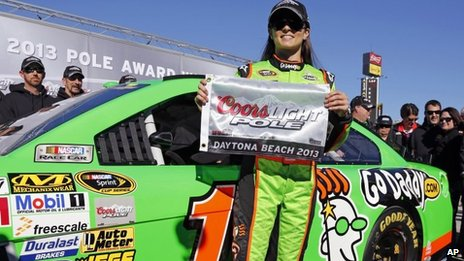 Danica Patrick holds a flag after winning pole position in the Daytona 500 in Daytona Beach, Florida 18 Florida 2013
