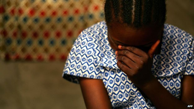 DR Congo rape victim talking to health worker