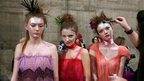 Models backstage at London Fashion Week