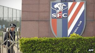 Police officer outside Shanghai Shenhua