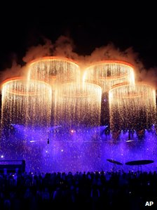 The Olympic Rings are forged above the stadium during the Opening Ceremony