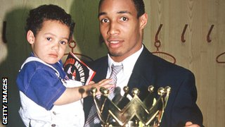 Paul Ince with two-year-old son Thomas and the Premier League trophy in 1994