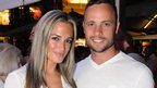 Pistorius, pictured here with Reeva Steenkamp, arrived at a court in South Africa on Friday morning to face charges of murder.