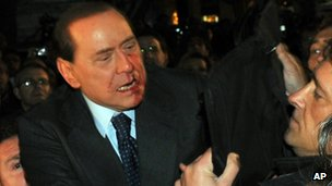 Silvio Berlusconi after being attacked