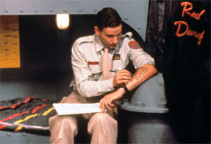 Rimmer writes on his arm in Red Dwarf
