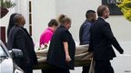 The coffin of Reeva Steenkamp is carried into the Victoria Park crematorium in Port Elizabeth for her funeral