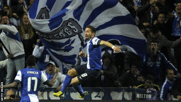 Joao Moutinho celebrates scoring against Malaga