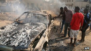 Wreckage of a car bomb outside Nigeria's capital, Abuja on 25 December 2011