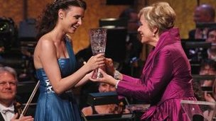 Dame Kiri Te Kanawa presents the Cardiff Singer of the World trophy to 2011 winner Valentina Nafornita