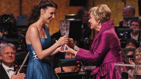 Dame Kiri Te Kanawa presents the Cardiff Singer of the World trophy to 2011 winner Valentina Nafornita