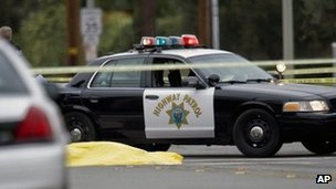 A body lays in the intersection of Wanda Road and Katella Avenue in Orange County, California 19 February 2013