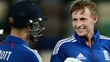 Joe Root (right) is congratulated by Jonathan Trott
