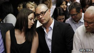 Oscar Pistorius's sister Aimee, brother Carl and father Henke await the start of court proceedings in the Pretoria Magistrates court, 20 February 2013
