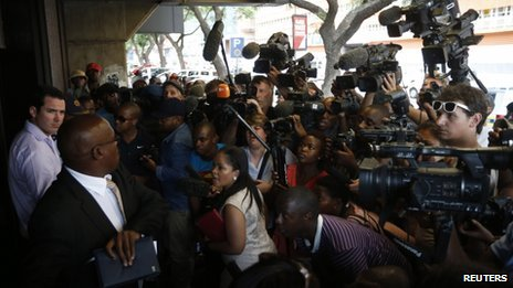 Journalists wait outside the Pretoria Magistrates court during the bail application of Oscar Pistorius, 19 February 2013