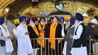 British Prime Minister David Cameron, centre, at the Golden Temple in Amritsar, Punjab, India