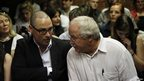 Oscar Pistorius' brother Carl and father Henke in the Pretoria Magistrates court, 20 Feb 2013