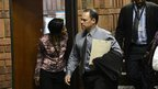South African police Detective Hilton Botha arrives on February 20, 2013 at the Magistrate Court in Pretoria