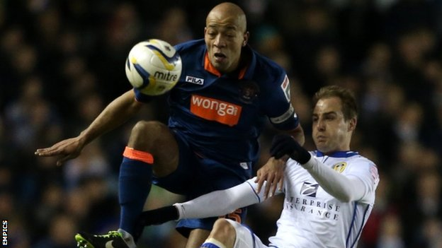 Leeds United's Luke Varney and Blackpool's Alex Baptiste (left)