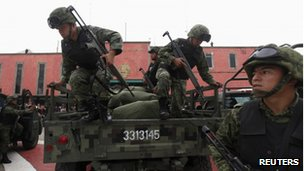 Soldiers get ready for a security operation in Ecatepec, Mexico