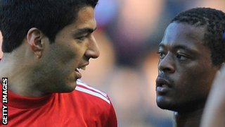 Luis Suarez and Patrice Evra