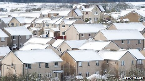 Homes covered in snow