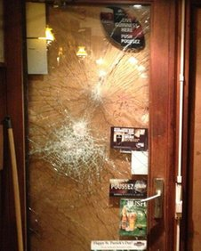 Damage to pub door