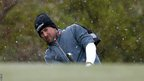Graeme McDowell chips in the snow