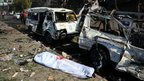 A handout picture released by the official Syrian Arab News Agency (Sana) on 21 February 2013 shows a body bag lying in the street following a powerful car bomb explosion near the headquarters of Syria's ruling Baath party in the centre of Damascus