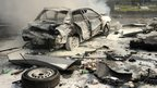 A handout picture released by the official Syrian Arab News Agency (Sana) on 21 February 2013 shows a a burnt-out car after a powerful car bomb exploded near the headquarters of Syria's ruling Baath party in the centre of Damascus.