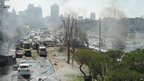 A handout picture released by the official Syrian Arab News Agency (Sana) on 21 February 2013 shows the aftermath of a powerful car bomb explosion near the headquarters of Syria's ruling Baath party in the centre of Damascus