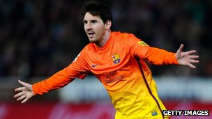 Lionel Messi of FC Barcelona celebrates after scoring his team's second goal during the La Liga match between Granada CF and FC Barcelona at Estadio Nuevo Los Carmenes, Granada, 16 February 2013