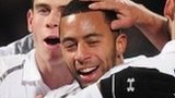 Tottenham celebrate with goalscorer Moussa Dembele