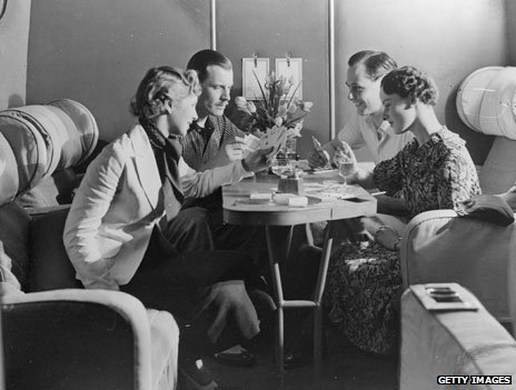 Passengers drink and play cards in the luxury of an Imperial Airways cabin (1936)